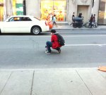 This dude was taking photos on Yonge Street during The National. When I tried to tweet this I couldn't. Prism.