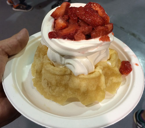 Swiss Waffle's & Crepes' Strawberries and Soft Serve On A Deep Fried Waffle.