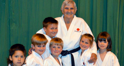 Dot Naylor and young karate participants.